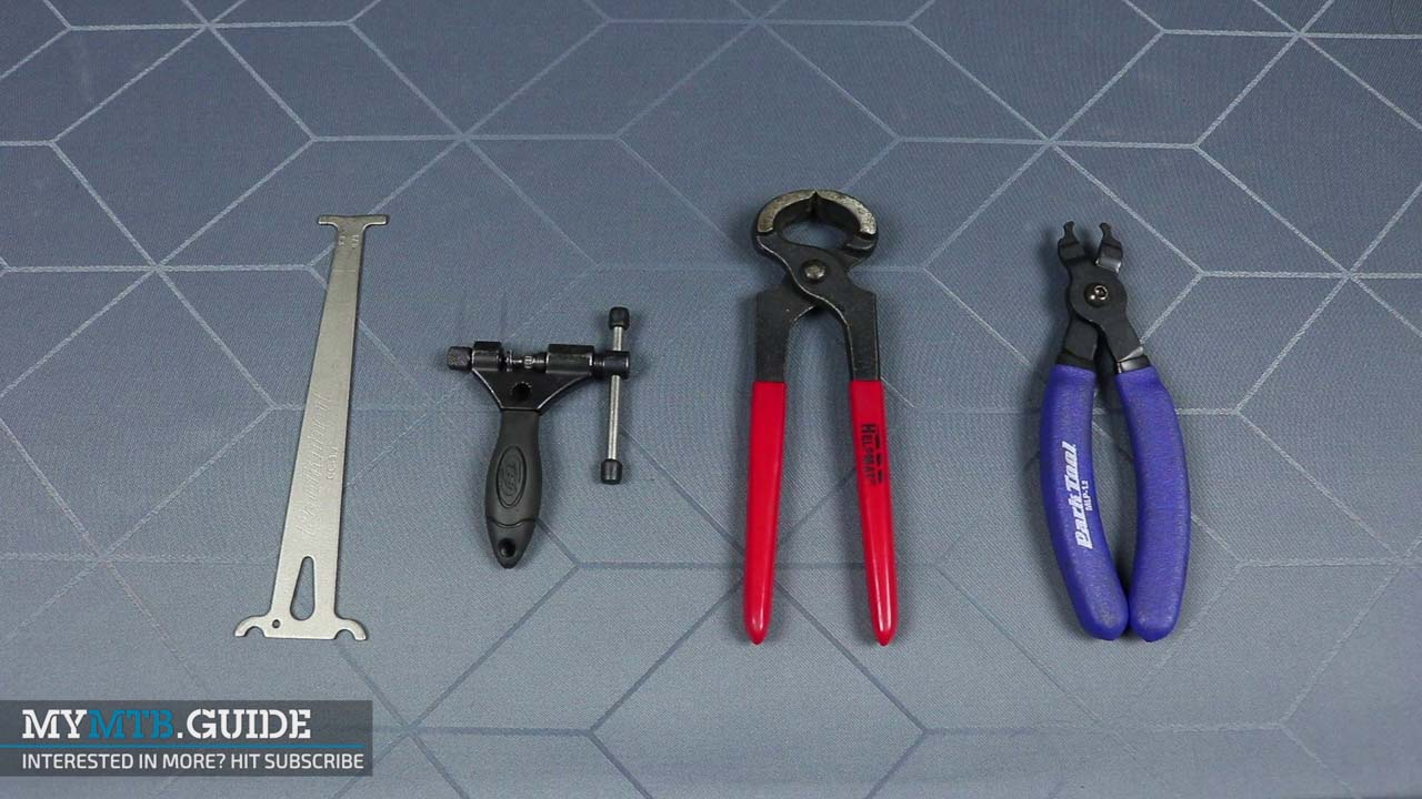 Tools (from left to right): chain wear indicator, chain device, pliers, master link pliers.